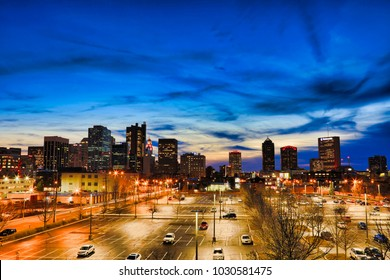 COLUMBUS, OHIO/USA - FEBRUARY 20, 2018:  Looking west at the Columbus, Ohio skyline cityscape at sunset showcases the landmark ART sign at the Columbus School of Art and Design, CCAD.