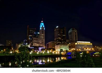 Columbus,Ohio skyline along the Scioto River with the Broad St. Bridge.