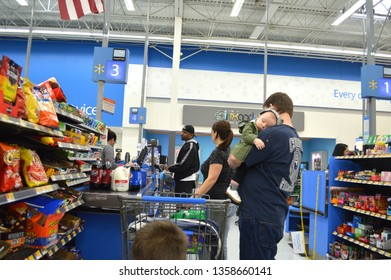 Columbus,Ohio/USA March 30,2019:  Walmart is the largest consumer retail chain in the country.  Consumers waiting  in line to pay for their purchases.