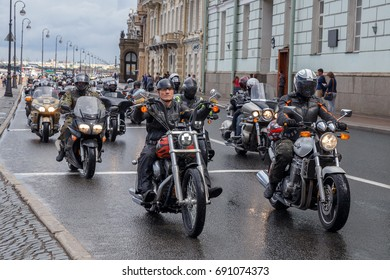 A column of bikers rides along Dvortsovaya embankment on August 5, 2017 in St. Petersburg, Russia