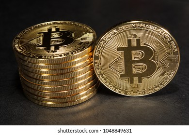 Column of bitcoins with one single coin next to them