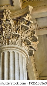 Column capital close up - architectural element of antique buildings decoration. Upper view of stone column decor - curved leaves. Detaile of Kazan Cathedral in St. Petersburg