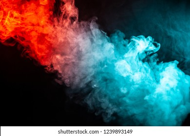 A column of colored smoke of green and red color from a wap of an abstract form tending upwards on a black isolated background.