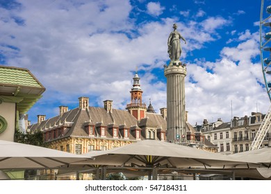Column of the Goddess - Memorial of the Siege of 1792  in the center square (Grand Place) of Lille, France over Christmas street market roofs
