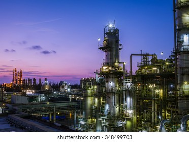 Column tower in petrochemical plant at dawn