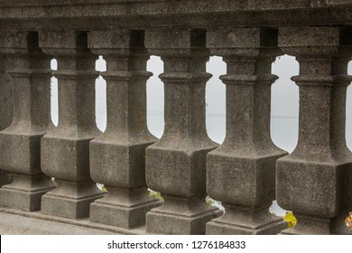 Columned gray stone wall with nice ornaments