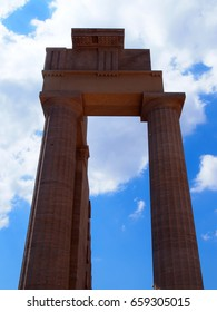 columns of the acropolis in lindos rhodes with blue sky and clouds in summer