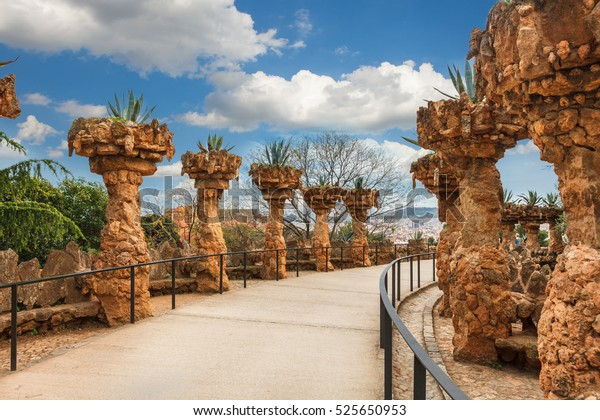columns among the trees made of stone in Park Guell designed by Antoni Gaudi in Barcelona, Spain, modernism style