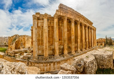 Columns of ancient Roman temple of Bacchus with surrounding ruins of ancient city, Bekaa Valley, Baalbek, Lebanon