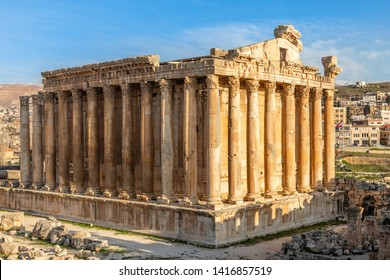 Columns of ancient Roman temple of Bacchus with surrounding ruins and blue sky in the background, Bekaa Valley, Baalbek, Lebanon