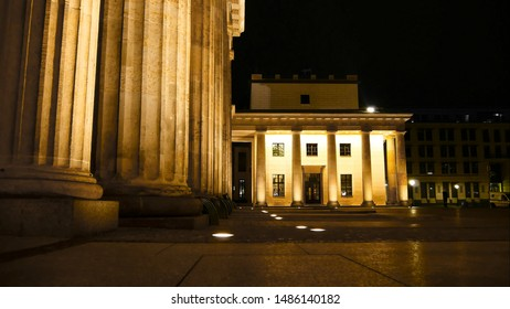 Columns of the Brandenburg Gate And part of the square in front of them. Without people. Brandenburg Gate at night in golden light. Elements of Greek architecture. Built as a symbol of peace.