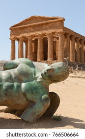 Columns of Concordia temple and statue of Icarus in Agrigento valley by a sunny day, Sicily
