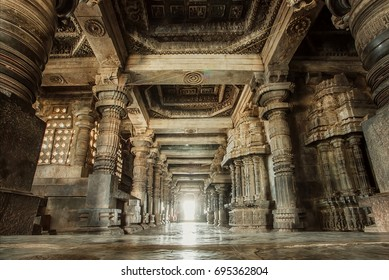 Columns and empty corridor inside the 12th century stone temple Hoysaleswara, now Karnataka state of India.