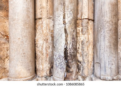 Columns at the entrance to Church of the Holy Sepulchre with crack - main pilgrimage destination contains Golgotha and the Tomb of Jesus Christ in Jerusalem