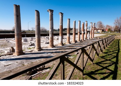 Columns and fence on Archeological area of Aquileia in Italy