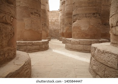 Columns with hieroglyphs of Karnak Temple in Luxor, Egypt. The temple complex at Karnak includes many ancient chapels, temples, monuments and columns of the ancient Egyptian civilization