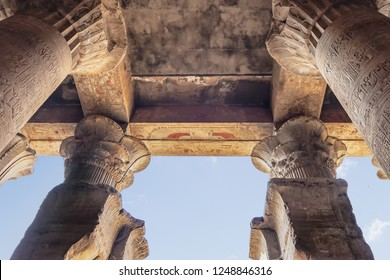 Columns with hieroglyphs and polychromy at Edfu Temple, Dedicated to the Falcon God Horus, Located on the west bank of the Nile, Edfu, Upper Egypt