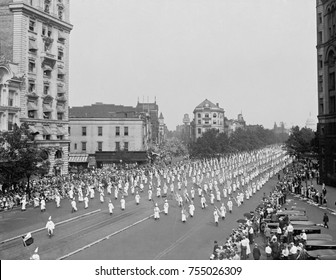 Columns of Ku Klux Klansmen march down Pennsylvania Avenue on August 8, 1925. They were among the 25,000 to 35,000 who marched unmasked in Washington, D.C.