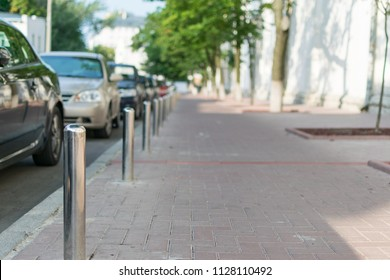 Columns to protect the sidewalk from the road.