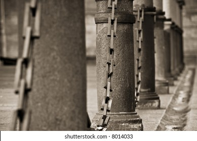 Columns united by chains in sepia color.