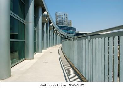 Columns, windows, balcony, and metal railing on modern building; Anaheim Convention Center; Anaheim, California