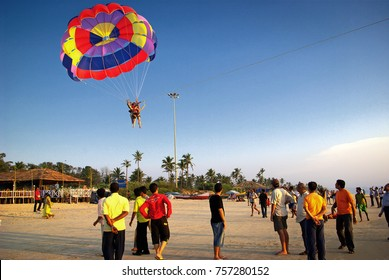 Colva Beach, South Goa, India. 15th October, 2016. Tourists enjoying adventure sports (Parasailing) at a sunny beach in Goa, India. Editorial.