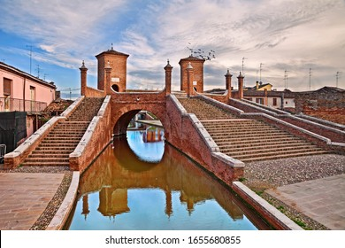 Comacchio, Ferrara, Emilia Romagna, Italy: the ancient bridge Trepponti, a famous five-way bridge in the old town known as the Little Venice