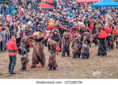 Comanesti, Bacau / ROMANIA - DECEMBER 30, 2018: Romanian rituals performed by participants dressed up in bear skins and traditional costumes. Participants use bells,drums to scare the bad spirits.