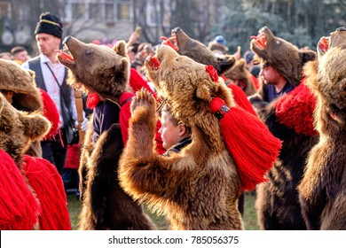 Comanesti, Bacau / ROMANIA - DECEMBER 30, 2017:Romanian rituals performed by participants with bells, sticks and drums making noise to dispel the malevolent spirits. Bear Dance being the most popular.