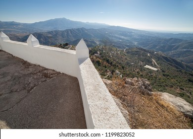 Comares cityscape. White village up on the hill of Malaga mountains, Andalusia, Spain. Panoramic view