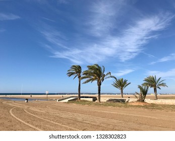Coma-ruga, Spain - June 14, 2018: Summer landscape with cloudy sky, thermal source, sea and palm trees in Coma-Ruga, Catalonia, Spain