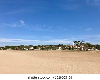 Coma-ruga, Spain - June 14, 2018: Summer landscape with sky, houses and palm trees in Coma-Ruga, Catalonia, Spain