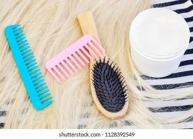 Comb, wig and coconut cream mask for hairs.Hair product concept