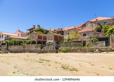 Combarro, Spain. The embankment of the old town with traditional horreo barns