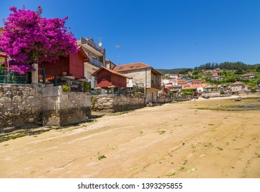 COMBARRO, SPAIN - JUN 15, 2017: The picturesque embankment of the town with traditional barns of horreo