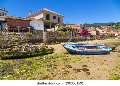 COMBARRO, SPAIN - JUN 15, 2017: Picturesque landscape with fishing boats and traditional horreo barn