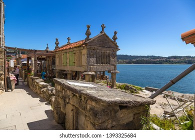 COMBARRO, SPAIN - JUN 15, 2017: Traditional barn horreo on the waterfront of the town