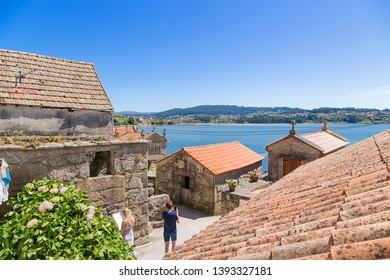COMBARRO, SPAIN - JUN 15, 2017:  horreo traditional barns on the shore
