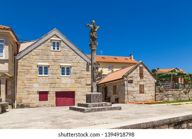 COMBARRO, SPAIN - JUN 15, 2017: sityscape of the old town with a stone cross