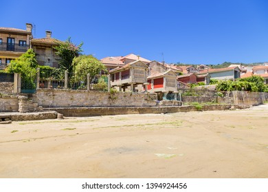 COMBARRO, SPAIN - JUN 15, 2017: embankment of the old town with traditional horreo granaries