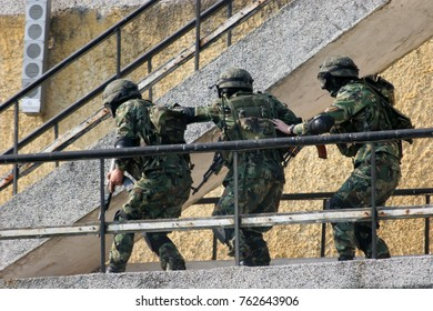 Combat Army soldiers participate in war actions during military training in boot camp. Military background. Command rangers during the military operation