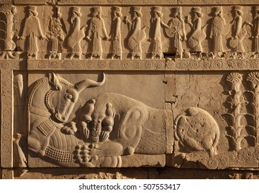 Combat of lion vs bull carved on the staircase wall of Persepolis UNESCO World Heritage Site near Shiraz, Iran.