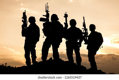 Combat ready special operation force group of soldiers in evening