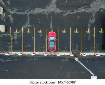 COMBER, CANADA - April 16, 2019: Aerial view of Tesla Supercharger in Comber, ON with Red Tesla Model S plugged-in, charging.