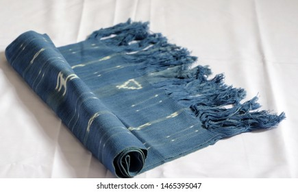 A combination of blue and beautiful images of white horses in tenun ikat Sumba. (weaving sumba).