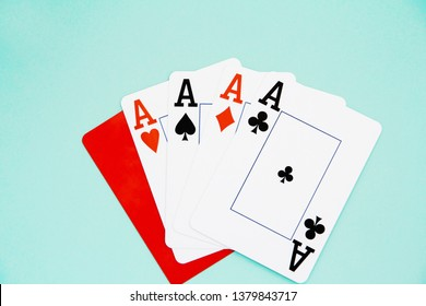 combination of four aces and red cutting card on blue isolated background.
