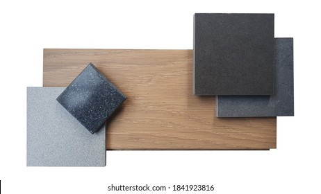combination of interior material samples containing black maquina marble ,black grained artificial stone surface ,grey and black stone texture tiles ,laminated wooden flooring.