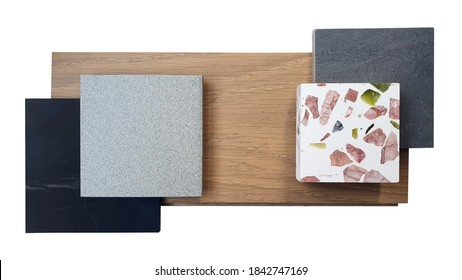 combination of interior material samples containing black maquina marble ,grey and black stone texture tiles ,laminated wooden flooring ,white terrazzo with large red and green stone fragments.