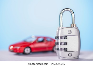 Combination lock with car in the background