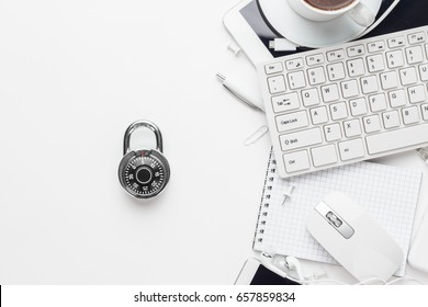 combination lock and different gadgets on white office table. privacy protection, encrypted connection concept, buying online